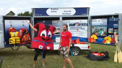 Buckles and Chad demonstrate boating safety
