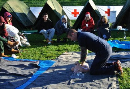 Participants in the Cold Campout learn CPR