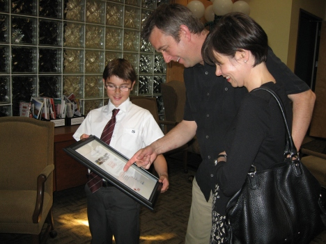 Connor and his parents Ian and Jane admire their son's Rescuer Award.