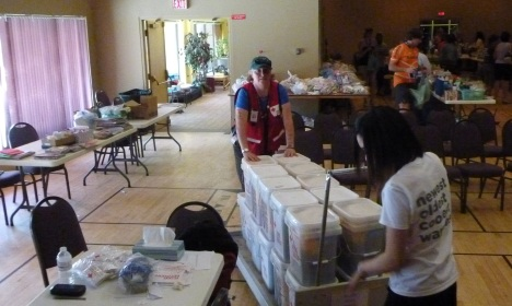 Red Cross assisting with clean-up kits